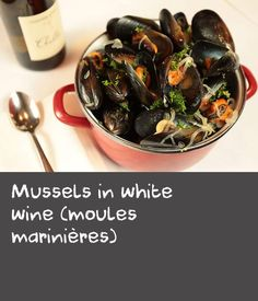 Mussels in white wine (moules marinières) | Mussels simply cooked in white wine, garnished with fresh parsley – there couldn't possibly be a better dish to serve with a cold beer (and perhaps a side of fries) on a hot summer afternoon. Making this recipe yourself at home is easy – and even quicker if you buy mussels that have already been scrubbed and debearded by a fishmonger.