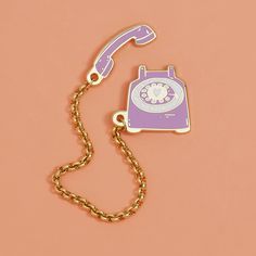 talk about hotline bling! this vintage-style double lapel pin by little arrow is too cute for words. 1-800-YOUNEEDTHISPIN - 0.8 in. x 0.1 in. & 0.5 in. x 0.8 in. - cloisonne hard enamel set in 22kt pl
