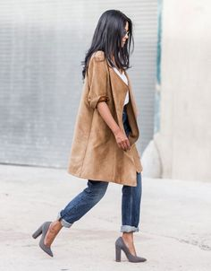 look calça jeans maxi casaco
