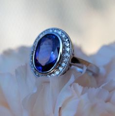 Gorgeous 14k white gold ring set with diamonds. features an amazing 2-2.5ct Tanzanite (eye clean violette-blue color). I think this is soo classy.