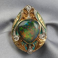 Gold, Opal, and Diamond Ring, bezel-set with a pear-shape cabochon opal measuring approx. 15.50 x 16.80 x 6.70 mm, the shaped mount with platinum, and full- and single-cut diamonds, scroll motifs, and enamel accents