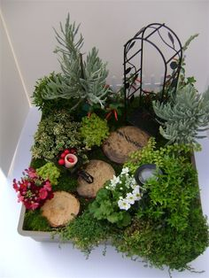 I love this idea for kids a fairy garden to evoke the imagination.  I secretly want one for myself :-)
