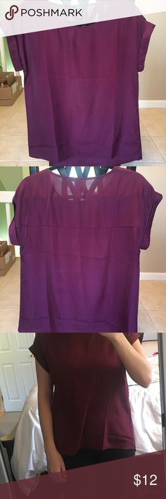 "Burgundy Business Casual Blouse! More of a silk material, very nice to pair with a blazer a pencil skirt!  DISCLAIMER: there is a deodorant stain on it, but if you plan on always wearing a blazer with it, it will be fine!   I am 5'3"" 34DDD Tops Blouses"