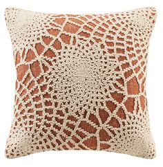 Set a relaxed mood for your home with our coral orange throw pillow. Features crochet-like hooked stitching in medallion designs atop solid cotton. The effect is soft and textural as well as durable.