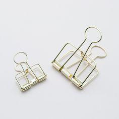brass, binder clips, office supplies, desk things