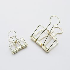 brass, binder clips, office supplies, desk things