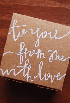 DIY Hand Lettered Gift Wrap... pretty white letters! #words