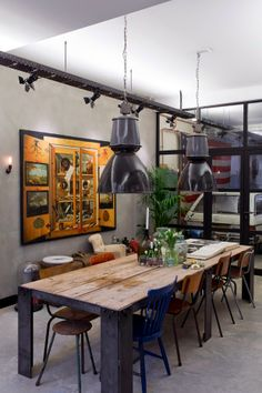 Industrial style. Mixed chairs, old wooden table, industrial lamps