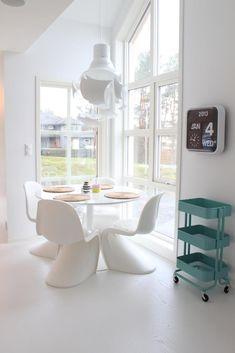 "Ikea ""Raskog"" bar cart and white Panton chairs"
