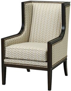 We love how this wingback's clean, angular silhouette and sweeping arms make a bold impact when lined in decorative nailhead trim and a glossy dark finish. Chevron-print upholstery padded with foam wrapped in down with a cotton duck core completes the look. Furniture > Chairs > Wingbacks.
