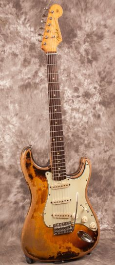 1960 Fender Stratocaster, all original, very worn condition. All electronics are original, including pickups, pots, tone cap, jack, switch, etc. Mint Green guard is original with one small repair on the horn. Knobs, switch tip, pickup covers, and trem cover are original. Original tuners, bridge, saddles, claw, strap buttons, string tree, etc. No extra string tree holes or any cracks or other issues