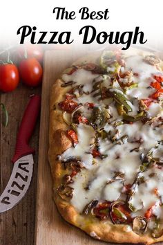 The best homemade pizza dough recipe you will ever make, never another store bought pizza dough again! Made with simple pantry staples, this easy pizza dough recipe is perfect with any pizza topping! The absolute Best Pizza Dough, this easy recipe will become your favorite go to for pizza night. Thick or thin crust you decide - it's always perfect. Making pizza is a great way to use up Christmas dinner leftovers! #pizza #dough #pizzadough #homemadepizza #christmaspizza