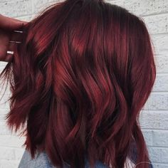 'Mulled wine hair' is one of winter's biggest hair color trends: Think a deep red base with orange and cinnamon tones layered in for dimension. #HairBeauty