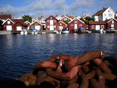 photo of Sweden, West Coast, Göteborg (Gothenburg) archipelago, red houses and a boat chain on the island of Gullholmen
