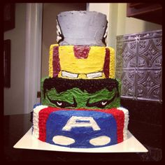 Avengers Birthday Cake:  I made this one myself, and I only make one cake a year & don't actually know what I am doing...but I think that if someone who actually knew how to bake and decorate cakes did something similar it would be great.  As it was, my seven year old loved it :0)  The top layer has wings on the side, as it's supposed to be Thor's Helmet...but there was no good way to get this in the picture.