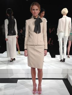 Cream skirt suit paired with a navy and white polka dot blouse at Marissa Webb's solo debut at NY Fashion Week.