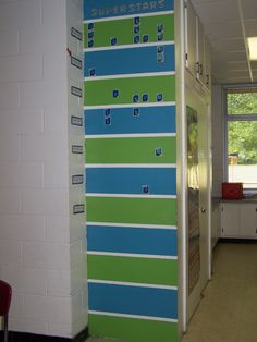 This is a vertical accelerated reader wall with horizontal lines. Could make it like a football field. Maybe along the cubby cabinet? Reading Is Thinking, Reading Counts, Elementary Library, Elementary Schools, Classroom Design, Classroom Decor, Reading Wall, Ar Reading, Accelerated Reader Program