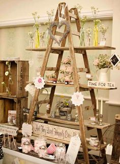 A ladder with boards cut to your desire would make a great portable display; the height provides excellent conservation of space.