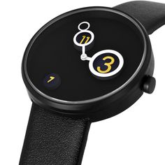 Moon Crater draws inspiration from its namesake with elevated gold numerals 3, 7, and 11 sitting atop raised platforms within a recessed case. The minute and hour hands move across the dial, perfectly encircling the raised numerals as they orbit the center. In black leather and steel, it's a unique design that either sex will appreciate. #design #minimal #watch