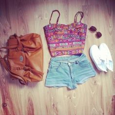 White converse, high waisted Jean shorts, colorful crop top, big bag