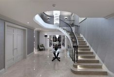 Dwelling with a formal symmetrical front located in a mature wooded site House Staircase, Modern Staircase, Staircase Design, Luxury Staircase, Curved Staircase, Spiral Staircases, Foyers, Bungalow Extensions, Residential Architect