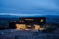 Architect Thomas Löwenstein has designed this black wooden house near Los Molles in Chile. Situated on a hillside near the beach town of Los Molles in Architecture Portfolio, Modern Architecture, Kitchen Garden Plants, Ohio House, Modern Buildings, Modern Houses, Beach Town, Black House, Beautiful Landscapes