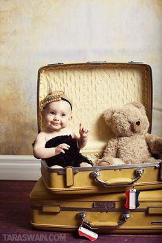 Taking great photos of you kids - cute baby girl with teddy bear inside the suitcase