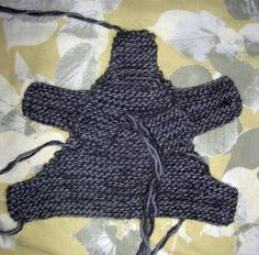 a knitted elephant  Here's another pattern that makes its way from knitter to knitter at my son's school.  I've retooled it for you here. I ...