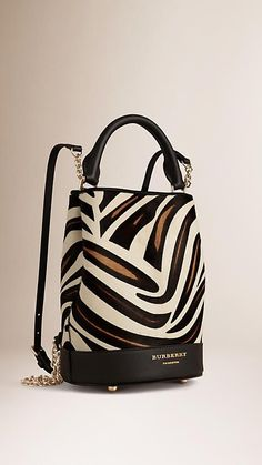 Burberry Bucket Backpack in animal-print calfskin with chain and leather straps.