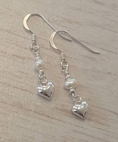 8a9926d7d Items similar to Sweetheart pearl earrings with freshwater pearls and  silver heart charms. Drop earrings. Hand made pearl earrings on Etsy