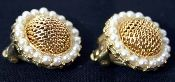 "Vintage Kramer of New York pearl and gold clip earrings. Very stylish gold mesh framed with faux pearls. Nice, heavy setting and clip-on back. Signed Kramer. 3/4"" in diameter. Mint condition. Fabulous pair of vintage earrings for your next night out on the town!"