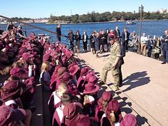 Prince Harry meeting school children on the steps of the Sydney opera house