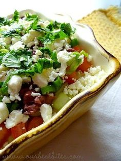 7-layer Greek dip  hummus, light cream cheese, cucumbers, tomatoes, chopped Kalamata olives, green onions, feta cheese, and a sprinkling of parsley. Plus, you can either scoop it up with whole-wheat pita chips or even vegetables. It*s a great variation of the classic Mexican 7-layer Dip minus the sour cream and cheddar cheese.