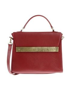 Yvonne Yvonne - Handbag. Comes in red or green #leather. Has a bottom with studs!! (Update: Aug 2013, found a bigger red alternative around the same price)