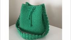 Various bag tutorials area available on Design-Peak. Today we are embedding yet another, highly interesting and beneficial video tutorial for those who want to learn how to make a beautiful crochet bag. The tutorial is divided into two parts. Crochet Shell Stitch, Easy Crochet, Crochet Baby, Knit Crochet, Crochet Handbags, Crochet Purses, Crochet Basket Tutorial, Crochet Backpack, Bag Women