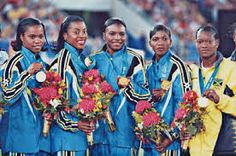 """At the 2000 Olympics in Sydney Australia, the five """"Golden Girls"""" of the Bahamas proudly accepted four gold medals and one silver medal—an amazing record for a country this small. Debbie Ferguson, Chandra Sturrup, Sevatheda Fynes, Pauline Davis-Thompson, and Eldece Clark-Lewis were dubbed the Golden Girls in 1999 after their first place finish at the prestigious World Championships in Seville, Spain."""