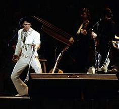 Elvis in concert in march 1  1970 at the Houston Astrodome.