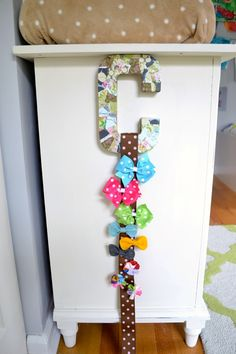 Mod Podge initial bow holder using a paper mache letter