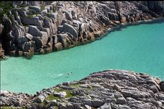 The UK, amazingly: A swimmer at a cove near Knockvologan on the Isle of Mull, off the west...