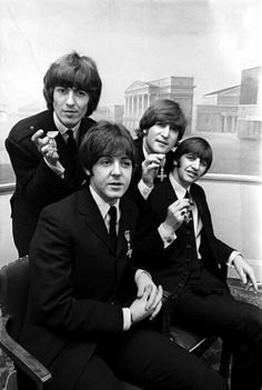 Beatles with their MBE awards