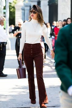 White turtleneck top Brown corduroy bootcut trousers Brown suede boots