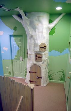 Use this tree as an entrance to under the stairs, making under the stairs a secret small play area, accessed by the tree door.