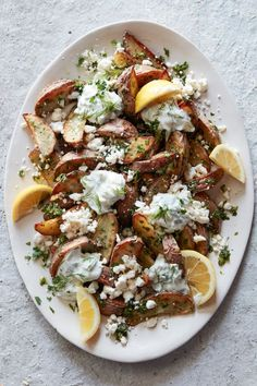 Greek Fries from www.whatsgabycooking.com - crispy potato wedges topped with tzatziki, feta and tons of herbs (@whatsgabycookin)