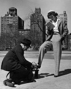 Shoe Shine and First Aid, Washington Square Park, 1968      Photographer: Nina Leen