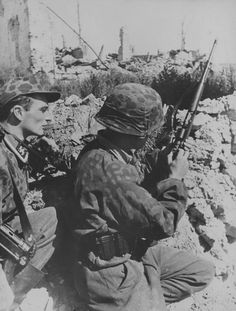 A Waffen-SS sniper right, in the ruins of a city on the eastern front.