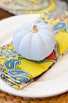 Vintage painted pumpkin place settings with Venice Paisley Napkins and Nantucket Dinnerware from #WorldMarket
