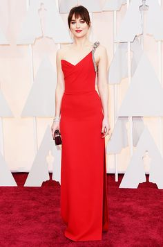 Dakota Johnson in a red Saint Lauren gown with a crystal strap and matching red lip at the 2015 Oscars