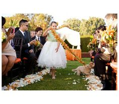 Puppy as Flower Girl escort. | 29 Perfectly Adorable Ways To Include Your Pet In Your Wedding