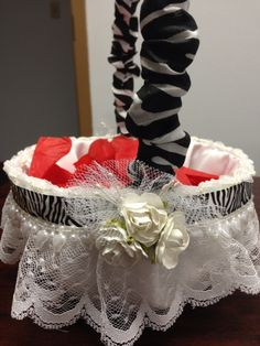 Flower girl's basket:  Traditional basket for younger child. Do it yourself with a basket. Over lay with satin fabric.  Handle - use plastic shipping strip or boning.  Cover it with fabric and add favorite layers of lace and trim and roses on the sides.  Fill with pedals.