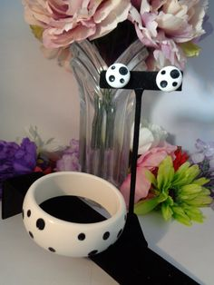 30% off coupon !  Les Bernard RARE Set of Black and White Polka Dots - The Earrings feature Clip Ons with Silvertone Hardware. The Bangle Bracelet and the Earrings are made of Lucite and are a stunning set. It is almost impossible to find a Black and White Les Bernard Polka Dot Set and now is you chance to get 30% off the listed price. Just go to  www.CCCsVintageJewelry.com and use the coupon code 772016. Take advantage of our Christmas in July Sale and get your 30% off. Have a great vintage…